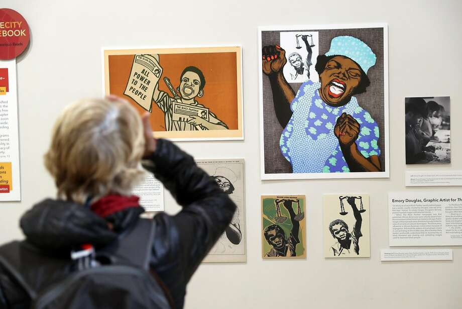A display of graphic illustrations from Black Panther Community Programs during the Black Comix Arts Festival at the San Francisco Library. Photo: Scott Strazzante, The Chronicle
