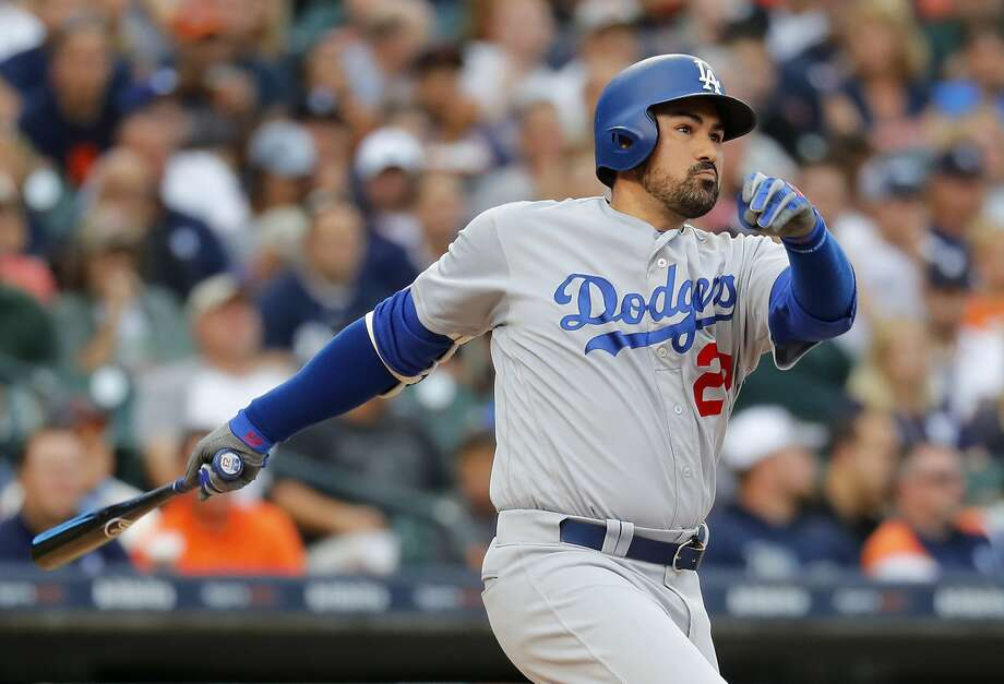 FILE - In this Aug. 18, 2017, file photo, Los Angeles Dodgers' Adrian Gonzalez hits a double against the Detroit Tigers in the second inning of a baseball game in Detroit. Adrian Gonzalez has been released by the Atlanta Braves and is a free agent. Atlanta acquired the 35-year-old as part of Saturday's five-player trade that sent outfielder Matt Kemp to the Los Angeles Dodgers and immediately designated him for assignment and placed him on waivers. Gonzalez waived his no-trade clause after the Braves agreed to cut him from their roster, and he was formally released Monday, Dec. 18, 2017. (AP Photo/Paul Sancya, File) Photo: Paul Sancya, Associated Press
