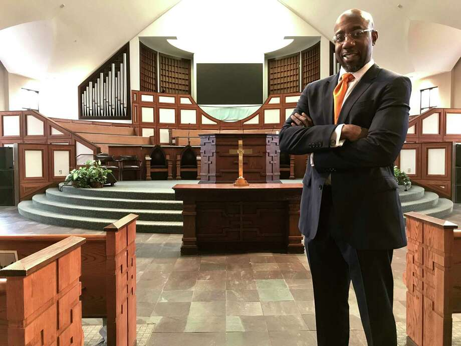 "The Rev. Raphael Warnock leads the congregation in Atlanta once led by the Rev. Martin Luther King Jr. ""We must choose to stand on the side of light and love,"" Warnock said. Photo: Jeff Martin, STF / AP"