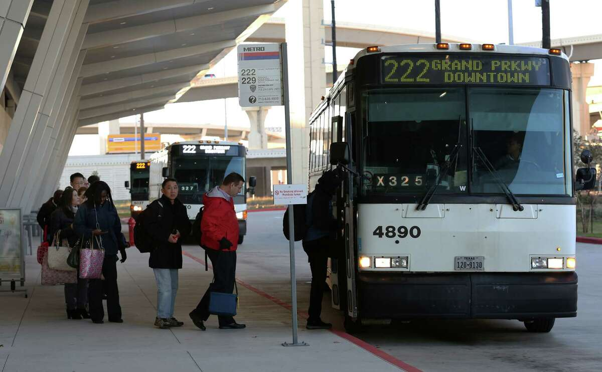 Commuters board a Metropolitan Transit Authority bus at the Grand Parkway park and ride in Katy.