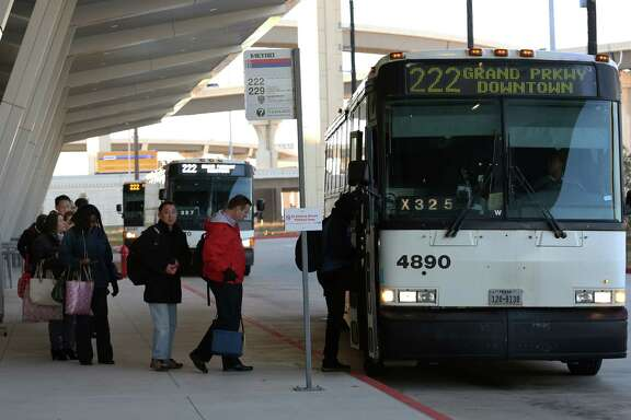 Commuters board a Metro bus at the Grand Parkway park and ride in Katy. The use of the park and ride has increased after officials opened a 1,650-space parking garage last February.