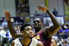 Albany Great Danes forward Alex Foster (34) moves the ball under the basket against the Iona Gaels during the first half of an NCAA men's college basketball game on Friday, Nov. 10, 2017, in Albany, N.Y. (Hans Pennink / Special to the Times Union) ORG XMIT: HP118