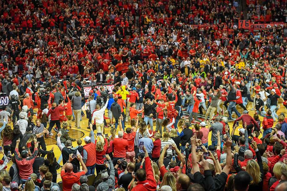 LUBBOCK, TX - JANUARY 13: The Texas Tech Red Raiders fans rush the court after the Texas Tech Red Raiders defeated the West Virginia Mountaineers 72-71 on January 13, 2018 at United Supermarket Arena in Lubbock, Texas. (Photo by John Weast/Getty Images) Photo: John Weast, Getty Images