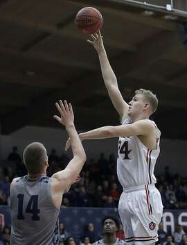 Saint Mary's (Cal.) center Jock Landale, right, shoots over Loyola Marymount center Mattias Markusson (14) during the first half of an NCAA college basketball game in Moraga, Calif., Thursday, Dec. 28, 2017. (AP Photo/Jeff Chiu)