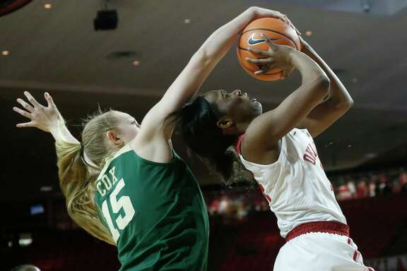 Baylor's Lauren Cox, left, blocks a shot by Oklahoma guard Shaina Pellington in the third quarter of Sunday's game in Norman, Okla. Baylor won 74-52.