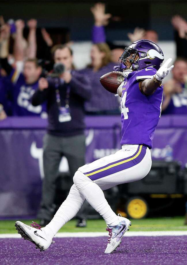 Vikings wide receiver Stefon Diggs triumphantly runs into the end zone to complete his game-winning 61-yard touchdown reception Sunday. Photo: Jamie Squire, Staff / 2018 Getty Images