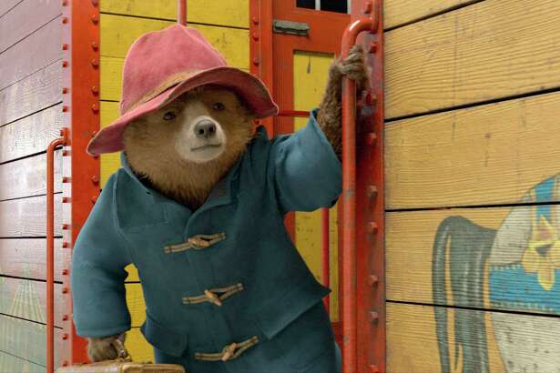"""This image released by Warner Bros. Pictures shows the character Paddington, voiced by Ben Whishaw, in a scene from """" Paddington 2."""" (Warner Bros. Pictures via AP)"""