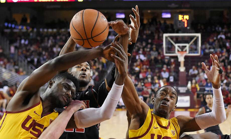 Southern California forward Chimezie Metu, and guard Shaqquan Aaron, right, reach for a rebound along with Utah forward Chris Seeley during the second half of an NCAA college basketball game, Sunday, Jan. 14, 2018, in Los Angeles. USC won 84-67. (AP Photo/Mark J. Terrill) Photo: Mark J. Terrill, Associated Press