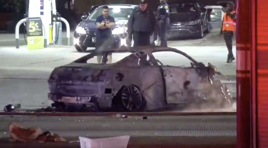 A driver had to be pulled out of a burning vehicle after a three-car collision early Monday, police said. Photo: Metro Video