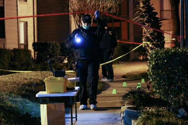 Houston Police officers investigate the scene where a man was stabbed to death at The Hudson Apartment Homes complex Monday, Jan. 15, 2018, in Houston.