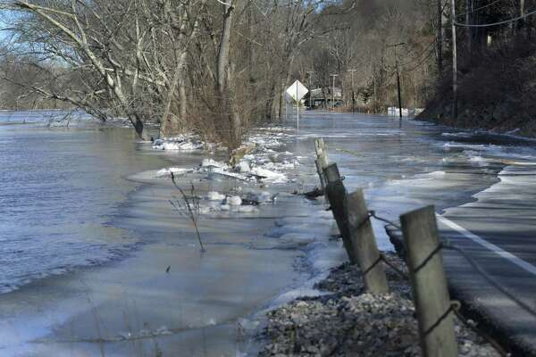 A massive ice jam and flooding has closed Route 7, from Route 341 to Bulls Bridge in Kent Sunday, January 14, 2018.