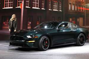 DETROIT, MI-JANUARY 14: Molly McQueen, granddaughter of iconic actor Steve McQueen, introduces the 2018 Ford Mustang Bullitt at its debut at the 2018 North American International Auto Show January 14, 2018 in Detroit, Michigan. More than 5,100 journalists from 61 countries attend the NAIAS each year. The show runs January 20-28. (Photo by Bill Pugliano/Getty Images)