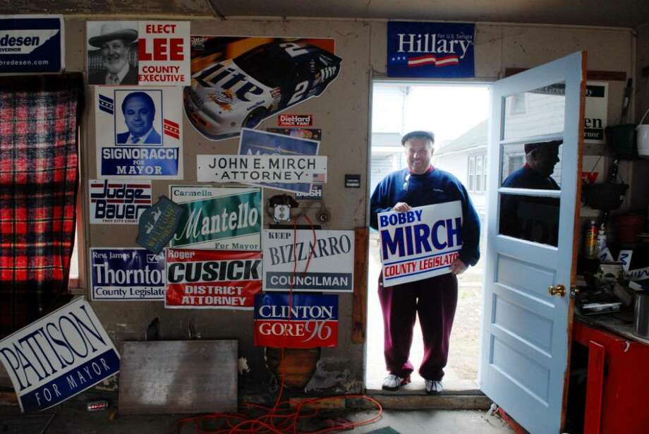 Bob Mirch, who says he?s ?officially retired from politics,? stands at his garage in Troy with a collection of political signs. (Paul Buckowski / Times Union) Photo: PAUL BUCKOWSKI / 00007020A