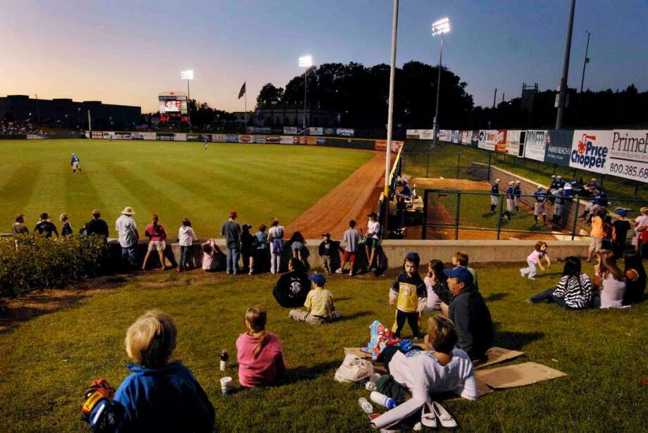 Baseball fans relax on the lawn near the vistor's bullpen as the Valley cats play the visiting Aberdeen Iron Birds at Joe Bruno Stadium in Troy. (Michael P. Farrell / Times Union ) Photo: MICHAEL P. FARRELL / 00004919A