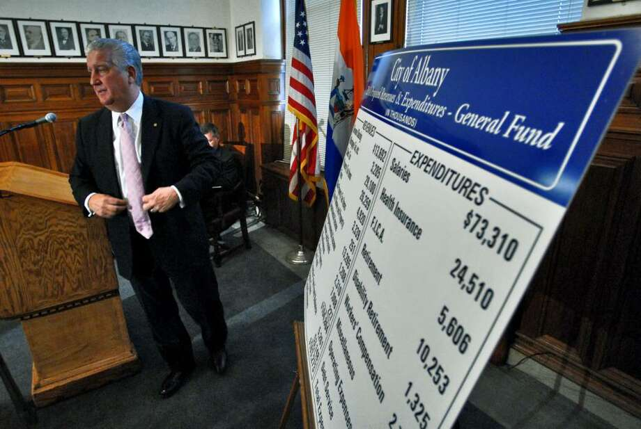 Albany Mayor Jerry Jennings walks from behind the podium after finishing an announcement  about his proposed budget for 2010 at City Hall on Thursday.  (Philip Kamrass / Times Union) Photo: PHILIP KAMRASS / 00005745A