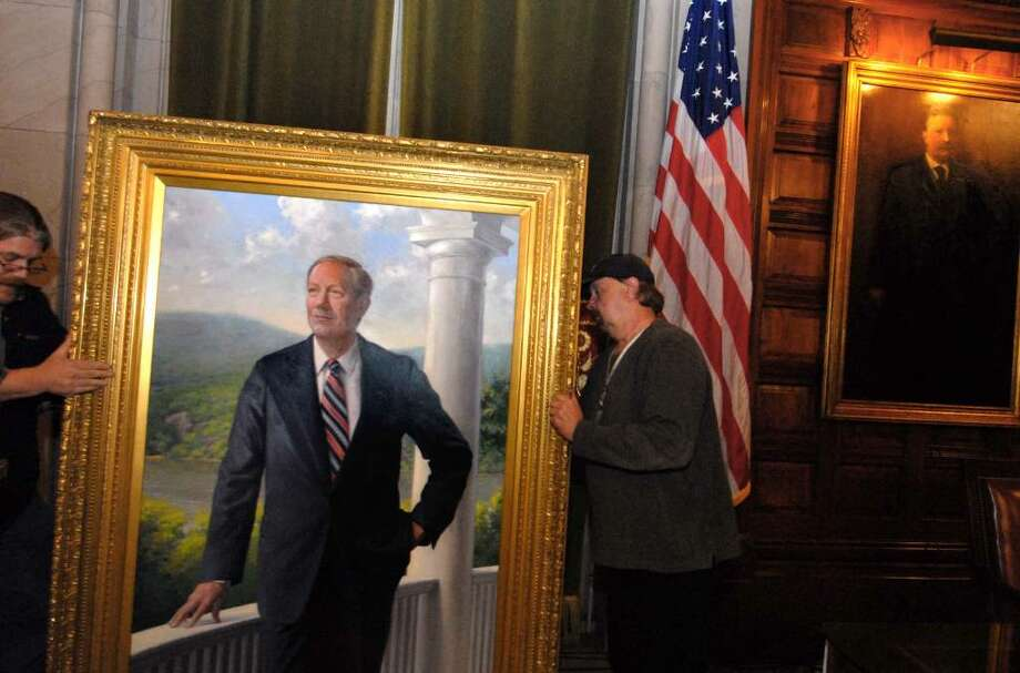 OGS workers Corey Smith , left, and Ernie Diehl move the official portrait of Gov. George Pataki after a ceremony Thursday at the Capitol?s Red Room.  Pataki, a Republican, served as governor from 1995 to 2006.  (Michael P. Farrell/Times Union) Photo: MICHAEL P. FARRELL