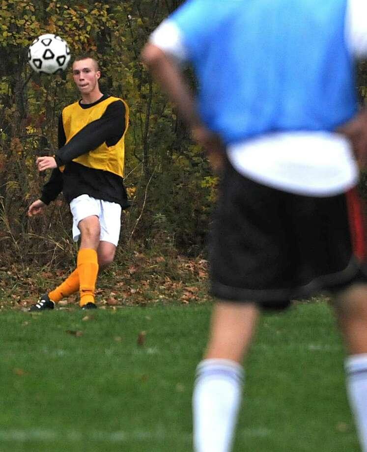 Kenny McDermith kicks the ball during soccer practice at Bethlehem High. (Lori Van Buren / Times Union) Photo: LORI VAN BUREN/TIMES UNION / 00006114A
