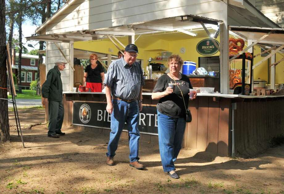 Glen and Roz Weatherholtz of Albany enjoy German food, drink and music at the Schuetzenpark Biergarten, the last original German Biergarten in the Capital District, on the grounds of the German-American Club of Albany, on Cherry Street in Colonie Friday afternoon August 7, 2009.  The Weatherholtz's look forward to coming to the Biergarten every year.  (John Carl D'Annibale / Times Union) Photo: John Carl D'Annibale / 00004974A