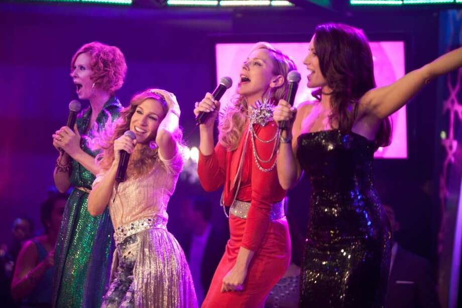 "(L-r) CYNTHIA NIXON as Miranda Hobbes, SARAH JESSICA PARKER as Carrie Bradshaw, KIM CATTRALL as Samantha Jones and KRISTIN DAVIS as Charlotte York-Goldenblatt in New Line Cinema's and Village Roadshow Pictures? romantic comedy ""Sex and the City 2."" (Warner Bros. Pictures) Photo: Craig Blankenhorn / © MMIX New Line Productions, Inc."