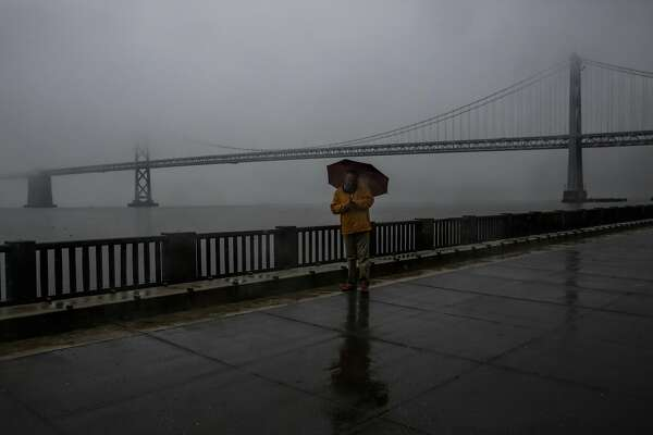 Roger E. pauses while walking on the Embarcadero during a rainstorm in San Francisco, Calif., on Monday, Jan. 8, 2018.