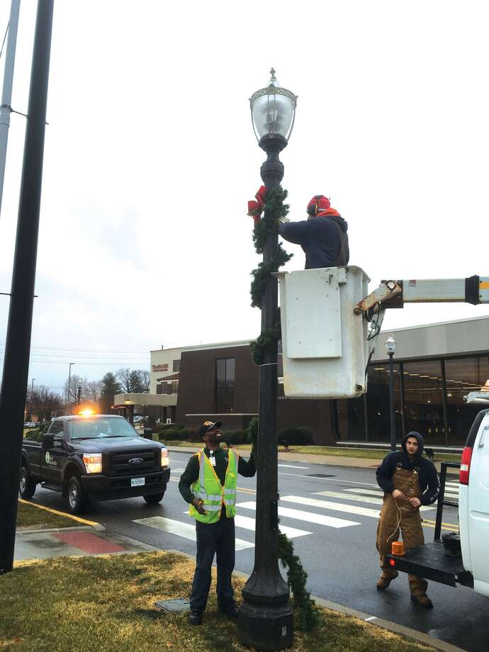 With a break from the bitter cold, Edwardsville crews were out last Wednesday taking down the Christmas decorations downtown. Photo: Bill Craft • For The Intelligencer
