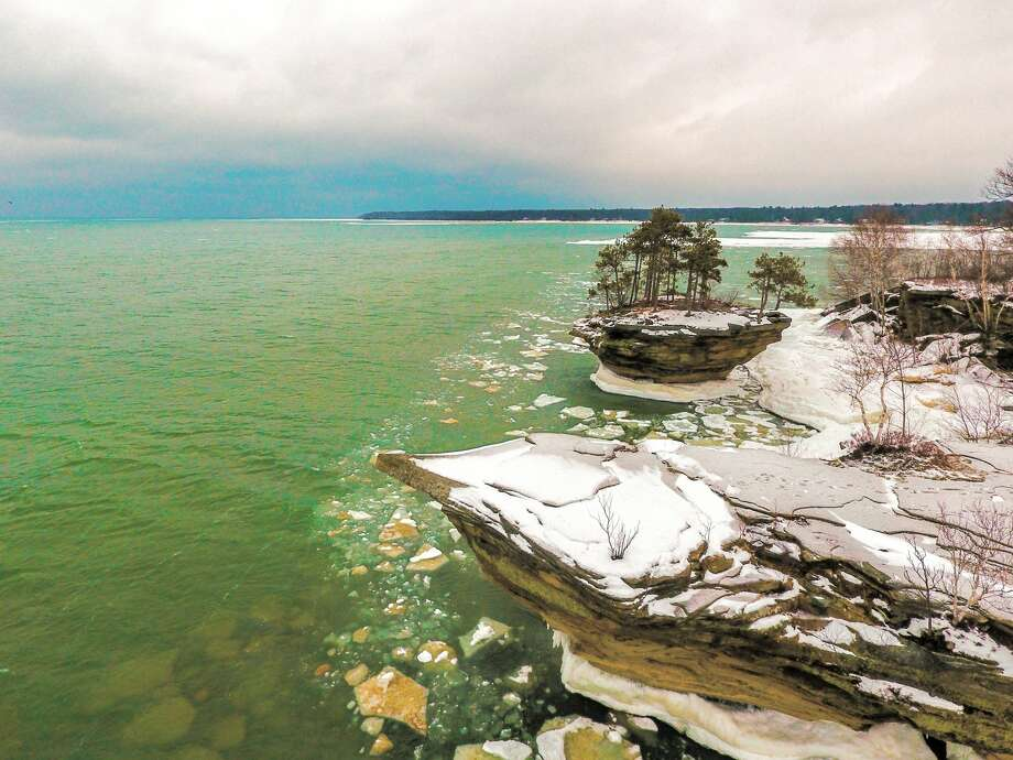 p.p1 {margin: 0.0px 0.0px 0.0px 0.0px; font: 12.0px Helvetica}This drone image captures chunks of ice near the shores by Turnip Rock in Port Austin. Photo: Tyler Leipprandt, Michigan Sky Media/For The Tribune