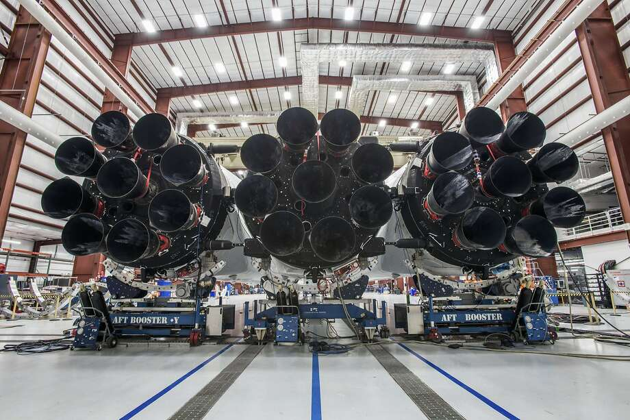 The Falcon Heavy rocket, seen in a hangar at Cape Canaveral, has 27 engines and is designed to hoist large payloads. A test launch is expected this month. Photo: Associated Press