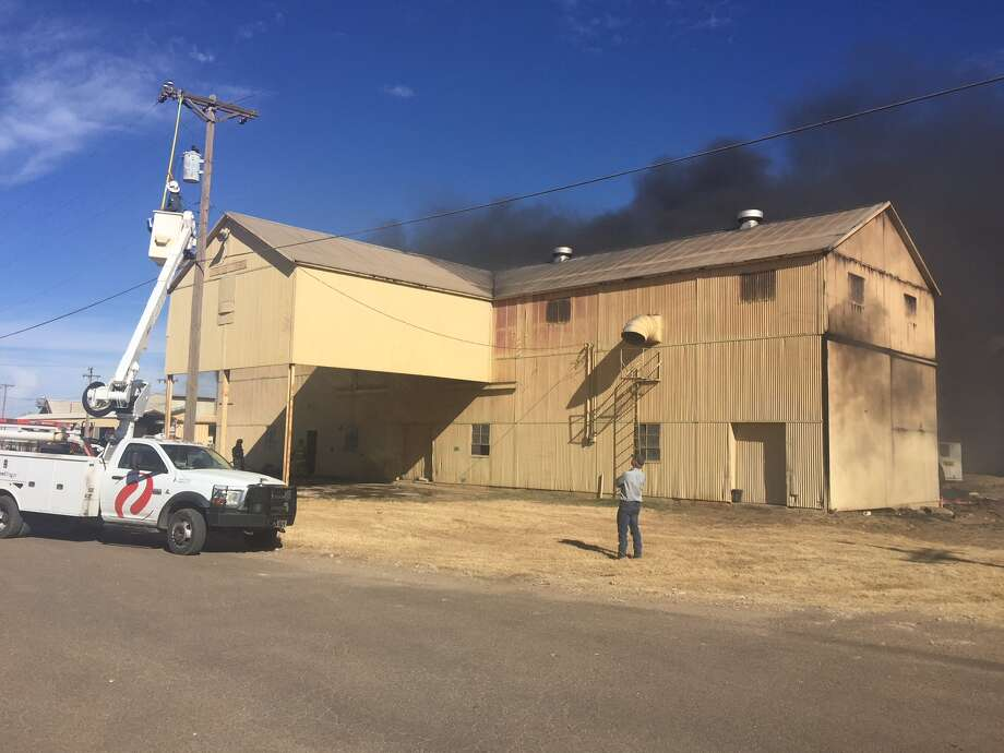 Black smoke billows from a fire in an old gin plant located on the grounds of the Hale Center Gin Tuesday afternoon.