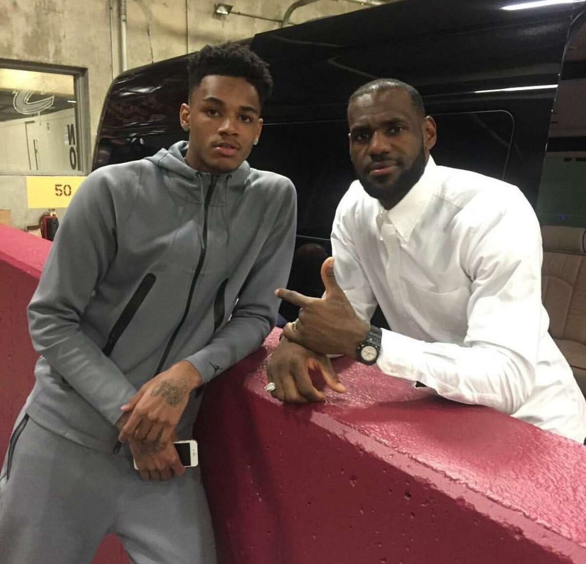 Dejounte Murray with LeBron James.