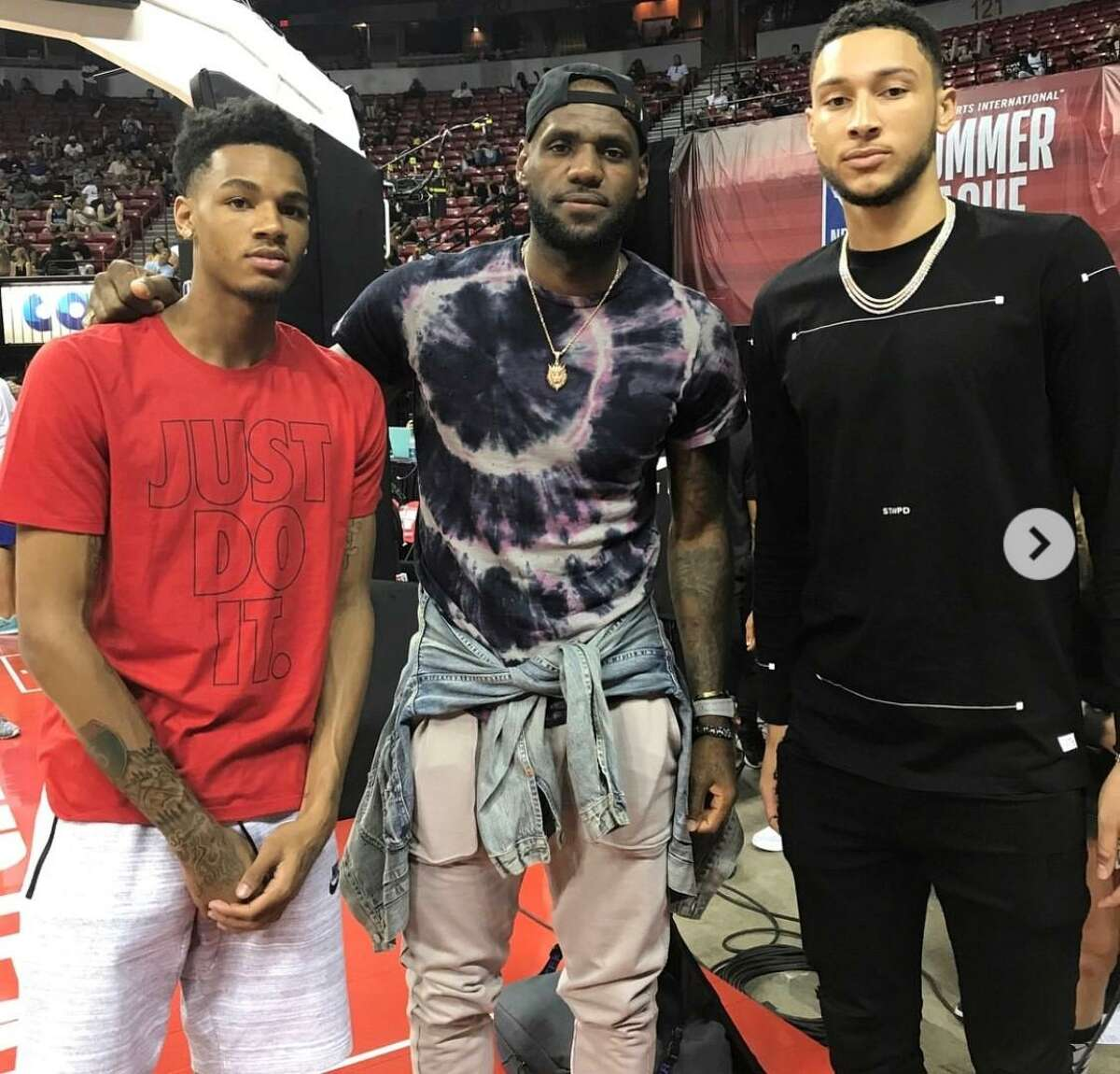 Dejounte Murray, left, with LeBron James, middle.