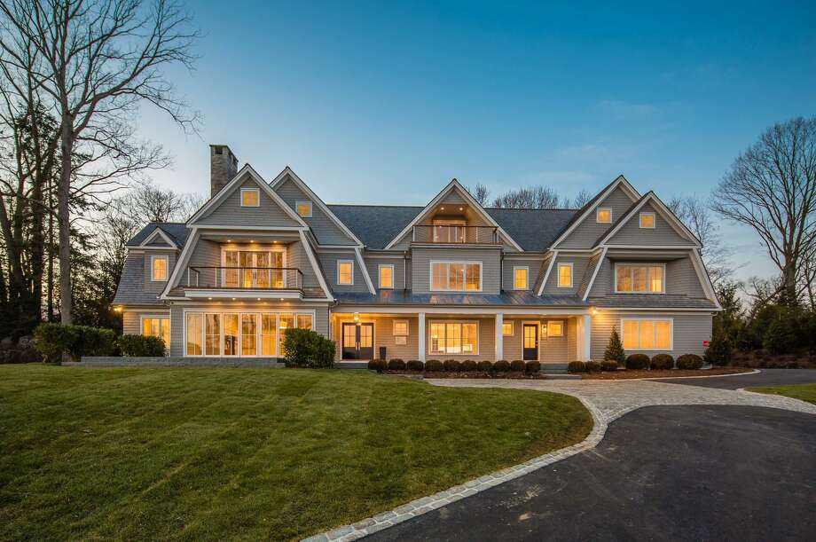 The newly constructed gray colonial house at 67 Salem Straits sits on a property of just over an acre in a private waterfront association.
