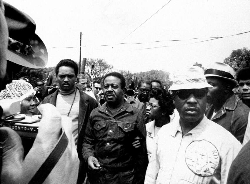 UNITED STATES - MAY 20: The Rev. Dr. Ralph Abernathy (center) and Mrs. Abernathy, with Jesse Jackson (left), as they tour Resurrection City with their staff during Poor People's March. (Photo by Fred Morgan/NY Daily News Archive via Getty Images)