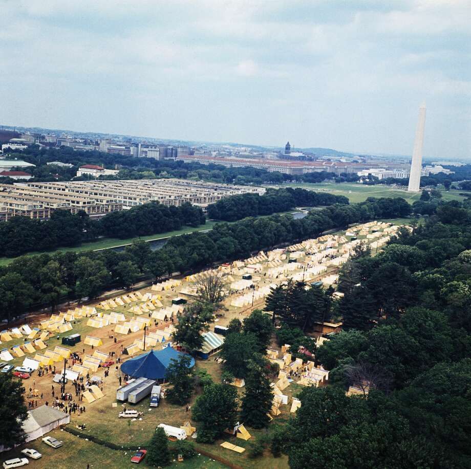 "(Original Caption) ""Resurrection City,"" a plywood and canvas encampment that will house some 3,000 participants in the Poor People's March on Washington is shown from the air. The Washington Monument is also shown. Photo: Bettmann/Bettmann Archive"