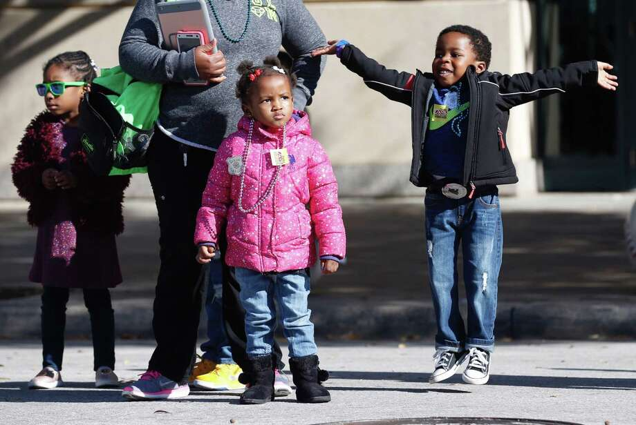 "Children watch The ""Original"" MLK Parade as it passes by Minute Maid Park on Monday, Jan. 15, 2018, in Houston. Photo: Brett Coomer, Houston Chronicle / © 2017 Houston Chronicle"