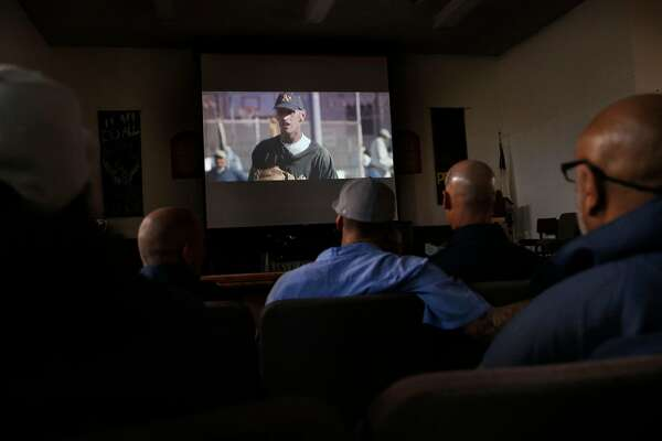"Inmates and guests gather for the screening of ""Through the Darkness"" a documentary about the San Quentin Baseball program at San Quentin Prison in San Rafael, Calif., on Tues. January 9, 2018."
