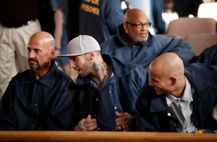 "Inmate Branden Riddle-Terrell, (center), one of the subjects of the film, with Tommy Wickerd, (left) and Brian Dietz as they get set  for the screening of ""Through the Darkness"" a documentary about the baseball program, at San Quentin Prison in San Rafael, Calif., on Tues. January 9, 2018."