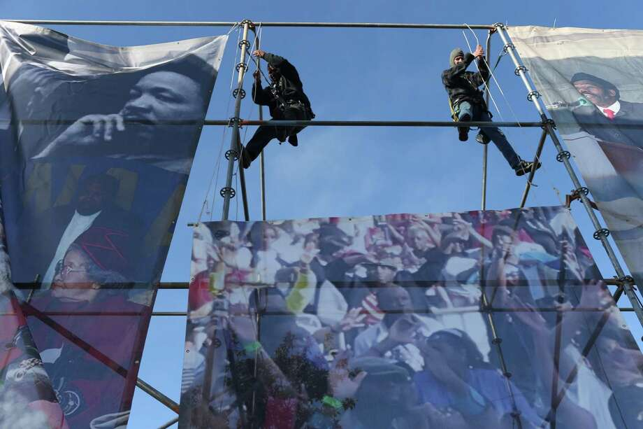Workers secure banners for the 50th Martin Luther King March at Pitman-Sullivan Park, Monday, Jan. 15, 2018. Featured speaker is syndicated columnist Roland Martin. Photo: Jerry Lara, Staff / San Antonio Express-News / 2017 San Antonio Express-News