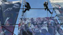 Workers secure banners for the 50th Martin Luther King March at Pitman-Sullivan Park, Monday, Jan. 15, 2018. Featured speaker is syndicated columnist Roland Martin.