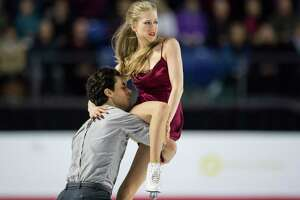 Andrew Poje, left, and Kaitlyn Weaver perform their free dance during the senior dance competition at the Canadian Figure Skating Championships in Vancouver, British Columbia, on Saturday, Jan. 13, 2018. (Jonathan Hayward/The Canadian Press via AP)