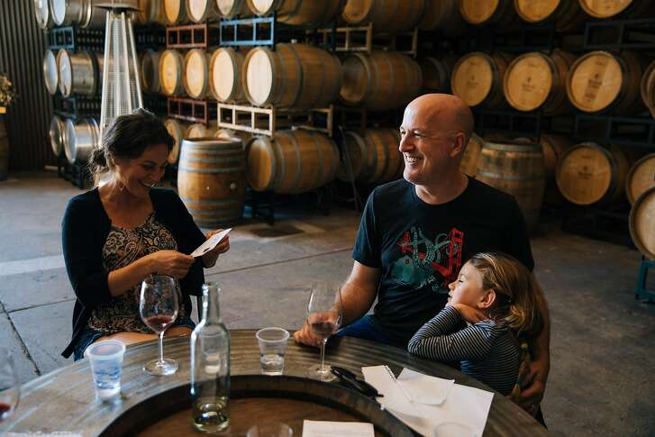Elan Emerson and Brett Emerson enjoy a laugh together with their daughter, Tilden Emerson, 5, at the Stockwell Cellars in Santa Cruz, Calif. Saturday, July 29, 2017.