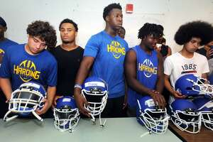 The Harding High School football team received new helmets for the upcoming season, in Bridgeport, Conn. Aug. 3, 2017.