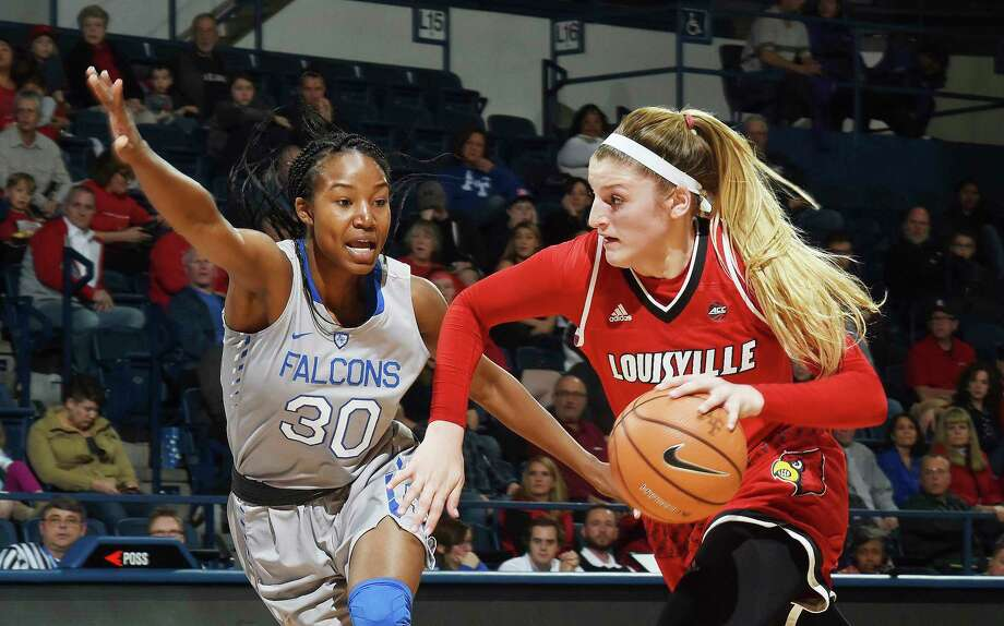 Louisville forward Sam Fuehring drives the ball past Air Force forward Naomi Hughes during the first half of an NCAA college basketball game at Air Force Academy, Colo., Wednesday, Dec. 20, 2017. Louisville won 62-50. (Jerilee Bennett/The Gazette via AP) Photo: Jerilee Bennett, Associated Press / The Gazette