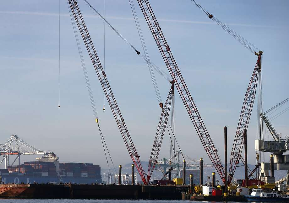 Cranes are docked near the site of a proposed coal storage and shipping facility at the Port of Oakland on Saturday, Jan. 13, 2018. Photo: Paul Chinn / The Chronicle