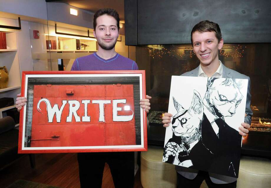 """J House Greenwich staff members Christian Gillis, left, and Mike Fusciardi with their artwork that will be featured as part of an upcoming employees art show at the J House Greenwich hotel in Greenwich, Conn., Friday, Jan. 12, 2018. Gillis is holding a photo he took of the side of a red building with the word """"Write"""" painted in white on it, taken in Asheville, N.C., Fusciardi holds a graphic artwork inspired by his cats titled """"Feline Good."""" Fellow staff member Meg Foster will also display her art at the exhibition. Photo: Bob Luckey Jr. / Hearst Connecticut Media / Greenwich Time"""