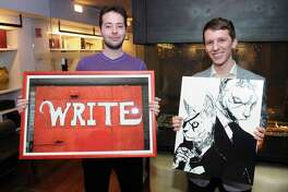 "J House Greenwich staff members Christian Gillis, left, and Mike Fusciardi with their artwork that will be featured as part of an upcoming employees art show at the J House Greenwich hotel in Greenwich, Conn., Friday, Jan. 12, 2018. Gillis is holding a photo he took of the side of a red building with the word ""Write"" painted in white on it, taken in Asheville, N.C., Fusciardi holds a graphic artwork inspired by his cats titled ""Feline Good."" Fellow staff member Meg Foster will also display her art at the exhibition."