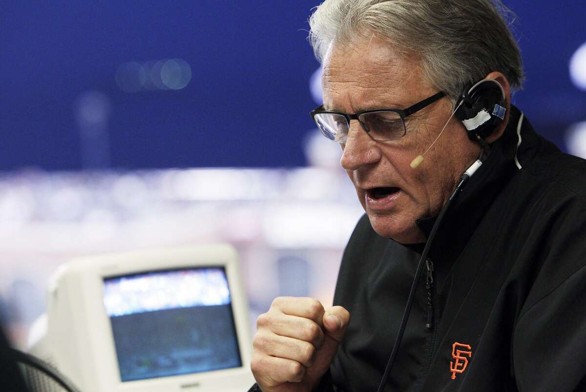Giants broadcaster Duane Kuiper reads an announcement between innings as he and Dave Flemming call the game from the KNBR radio booth as the San Francisco Giants played the Oakland Athletics in a pre-season game at AT&T Park in San Francisco, Calif., on Thursday, March 27, 2014. Broadcasters throughout the game are bombarded by countless statistics which dissect a player's success to the finest detail. While some broadcasters use them, others prefer call their games with good old fashioned research done firsthand.