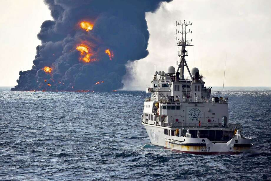 A rescue ship sails near the burning Iranian oil tanker Sanchi on Sunday in the East China Sea. The tanker later sank. Photo: Associated Press