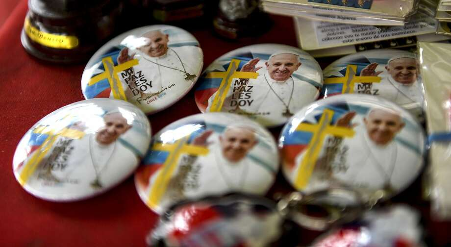 Pins of Pope Francis are sold at a street stall ahead of the pontiff's visit to Chile, in Santiago, on January 13, 2018.  Pope Francis will be visiting Chile from January 15 to 18. / AFP PHOTO / MARTIN BERNETTIMARTIN BERNETTI/AFP/Getty Images Photo: MARTIN BERNETTI, AFP/Getty Images
