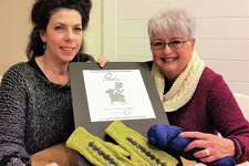 Nancy O'Connell (right), owner of nancy O in Ridgefield, Conn., with artist Amy Bock, who designed the labels for the nancy O private-label yarns.