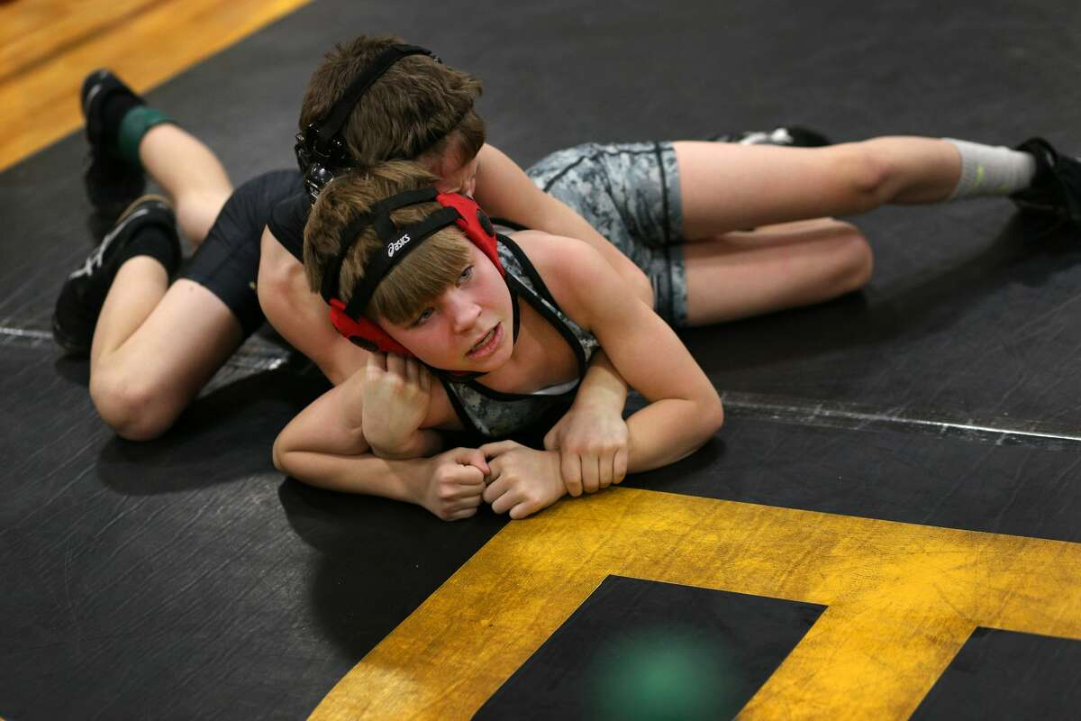 Ethan Westover of South Lyons competes against Noah Szwed of Montrose during the Bullock Creek Youth Wrestling Tournament on Saturday, Jan. 13, 2018. (Samantha Madar/for the Midland Daily News)